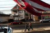 Two Latino residents walk down the street on February 1 2012 in East Haven Connecticut Following an investigation by the FBI four East Haven police...
