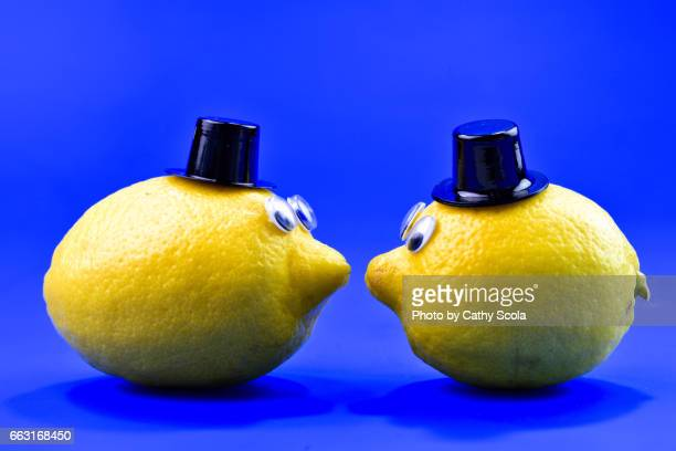 Two Lemons with Faces