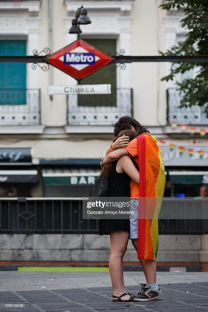two lesbian girls embraces at the front of Chueca subway station on the last day of Madrid Gay Pride Festival 2013 on July 7, 2013 in Madrid, Spain. According to a new Pew Research Center survey about homosexual acceptance around the world, Spain tops gay-friendly countries with an 88 percent acceptance rate.