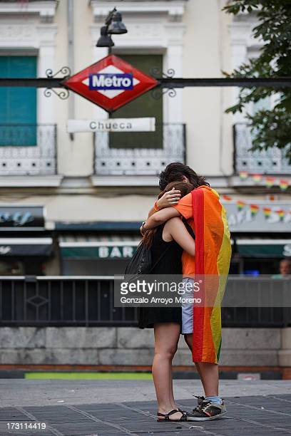 two lesbian girls embraces at the front of Chueca subway station on the last day of Madrid Gay Pride Festival 2013 on July 7 2013 in Madrid Spain...