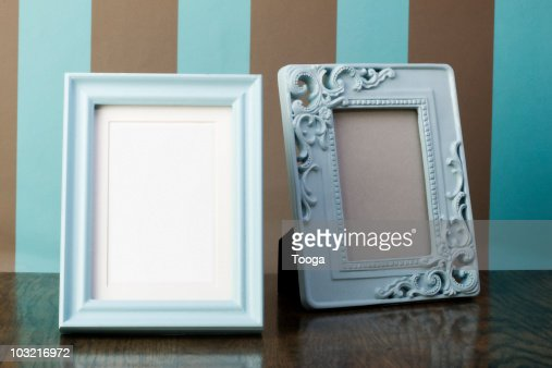 Photo frame on table stock photos and pictures getty images for What to do with empty picture frames