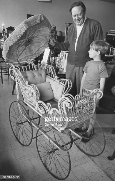 Two Lindemiers Look at 1880 Baby Carriage Carroll Lindemeier shows store to his son Michael8 Credit Denver Post