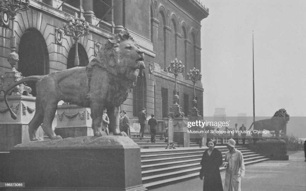 Two lion statues guard the entrance to the Art Institute of Chicago as it appeared during the Century of Progress International Exposition The...
