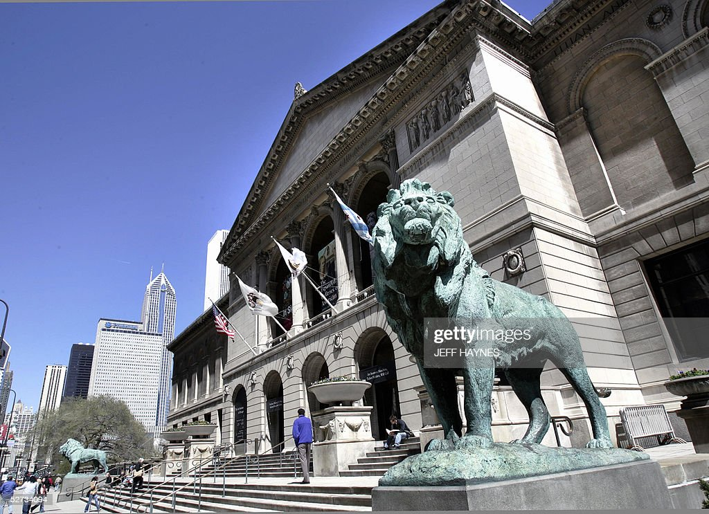 Two lions guard the entrance to The Art Institute of Chicago along Michigan Avenue 22 April 2005 The institute was founded in 1879 as both a museum...