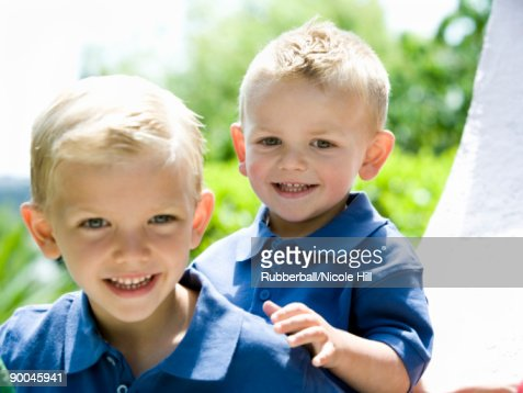 two little boys in blue shirts : Stock Photo