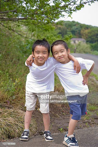 Two little boys standing together, Machida, Tokyo Prefecture, Japan