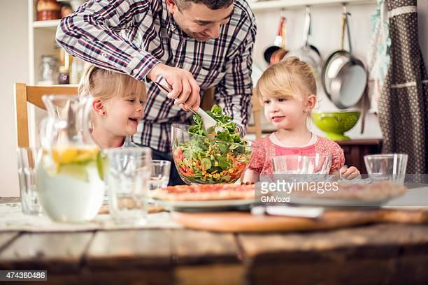 Two Little Girls Eating Fresh Salad