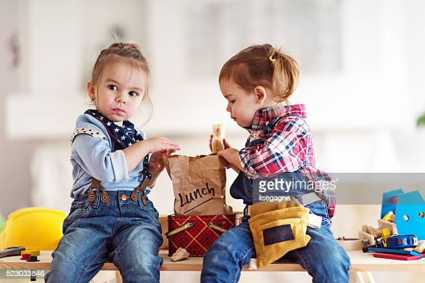Two Little Girls having Lunch Break