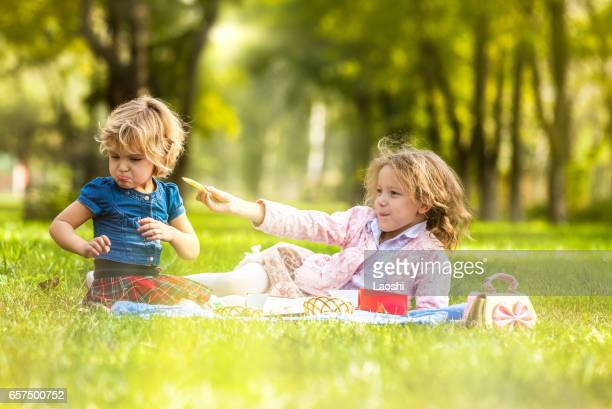 Two little girls on picnic