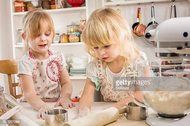 Two Little Girls Preparing Cookies in the Kitchen