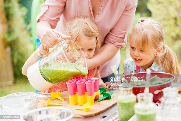 Two Little Girls Preparing Popsicles at Home