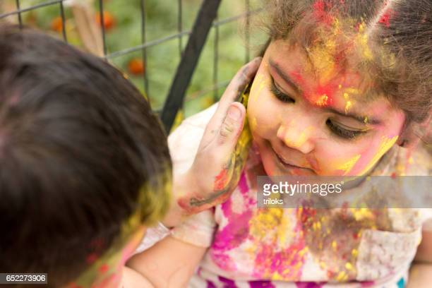 Two little kid celebrating holi