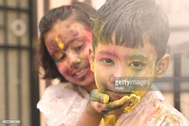 Two little kid playing with colors