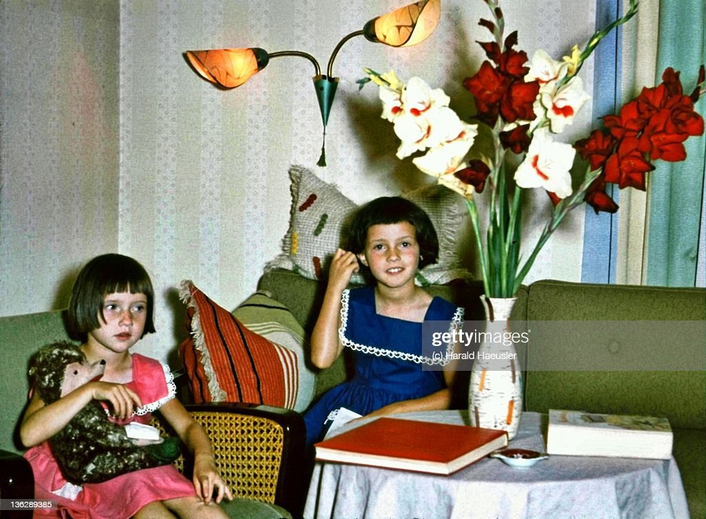 Two little red and blue dressed girls : Stock Photo