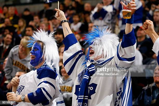 Two lively fans of the Toronto Maple Leafs celebrate a goal against the Ottawa Senators in a game at Scotiabank Place on November 17 2009 in Ottawa...