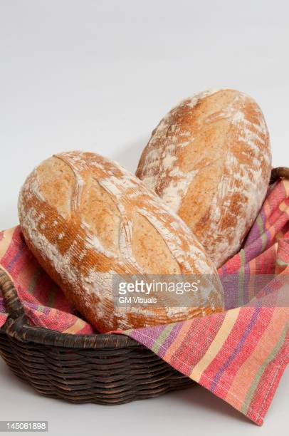 Two loaves of fresh bread in basket