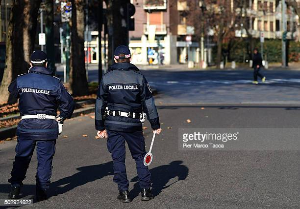 Two local policemen in Milan at a checkpoint during the third day of a traffic ban on December 30 2015 in Milan Italy The city of Milan has...