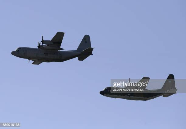 Two Lockheed C130 Hercules of the Argentine Air Force take part in the celebrations of the 207th anniversary of the May Revolution in Buenos Aires on...