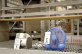 Two lone fans for sale on a nearempty shelf at a Lowe's home improvement store August 2 2006 in Arlington Heights Illinois With the heat wave...
