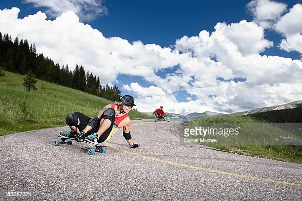 Two longboarders taking a sharp turn.