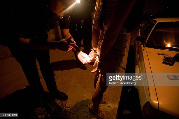Two Los Angeles police officers question a suspected drug dealer and a KoreanAmerican woman after finding a small quantity of speed and a smoking...