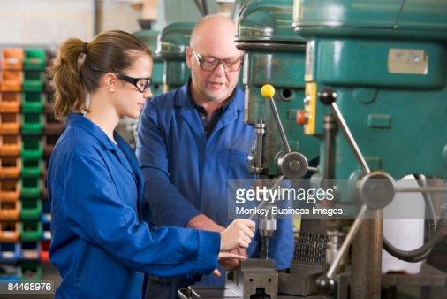 Two machinists working on machine : Stock-Foto
