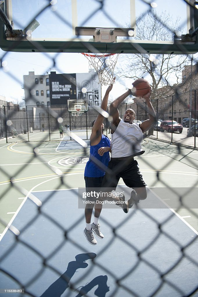 Two Male Adults Playing One on One Basketball : Stock Photo