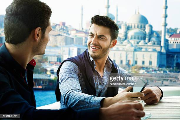 Two male friends discussing girls on a yacht in Istanbul