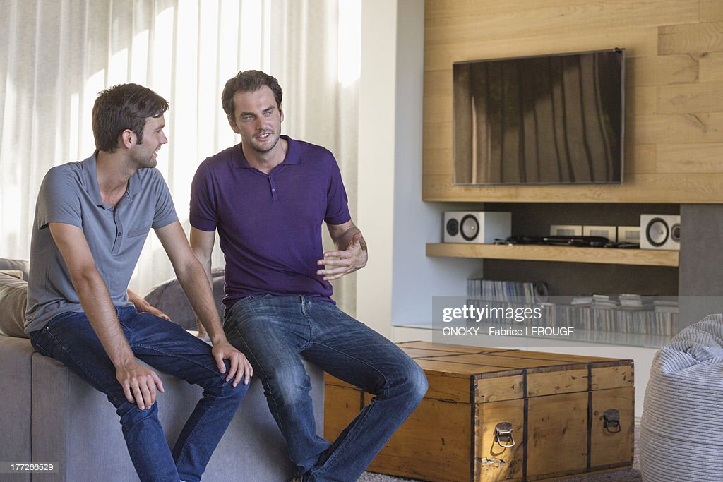 Two male friends discussing : Stock Photo