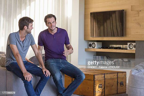 Two male friends discussing