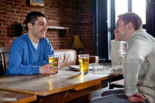 Two male friends enjoying a pint