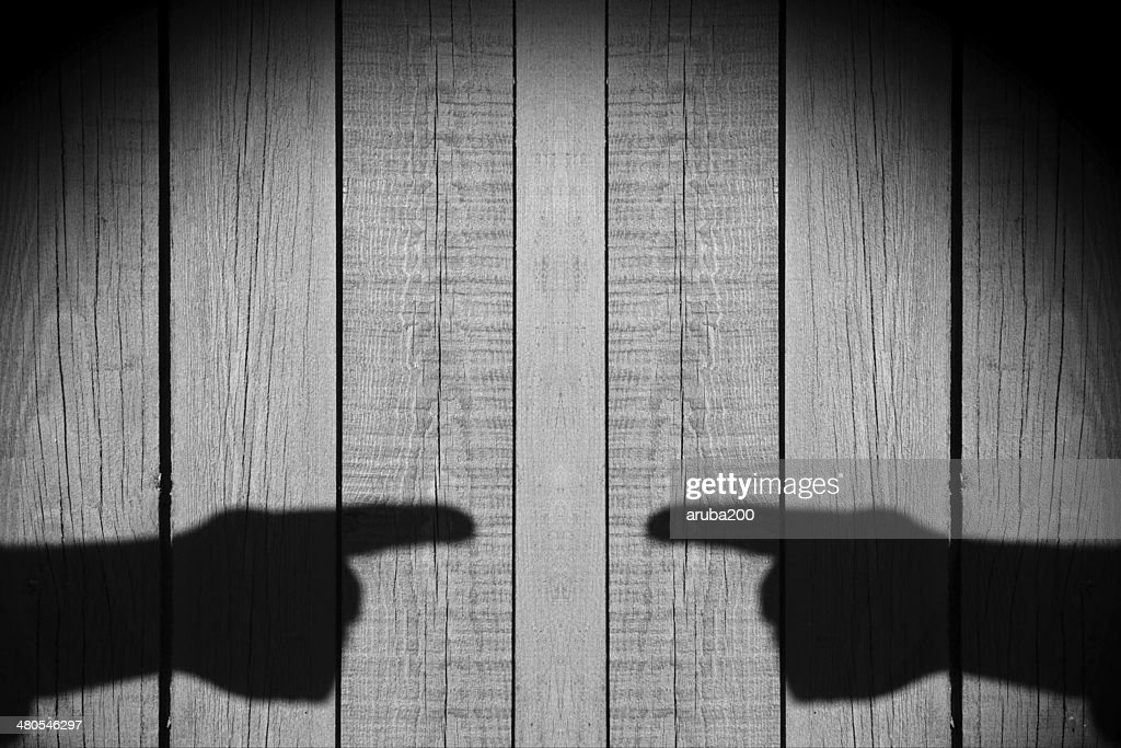 Two Male Hands with index finger on a wooden background : Stock Photo