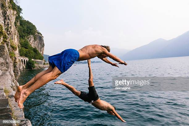 Two man diving in the water