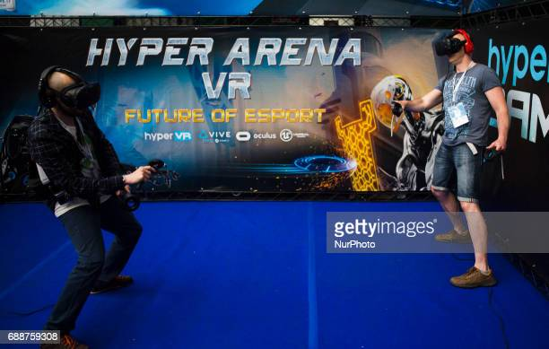 Two man in virtual reality glasses on Pixel Heaven fair in Warsaw 26 May Poland