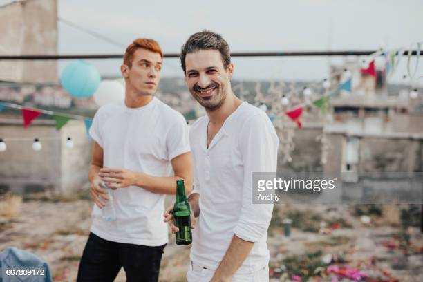 Two man on the rooftop party