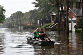 Two man row a boat on a flooded street in Charleston South Carolina on October 4 2015 Relentless rain left large areas of the US southeast under...
