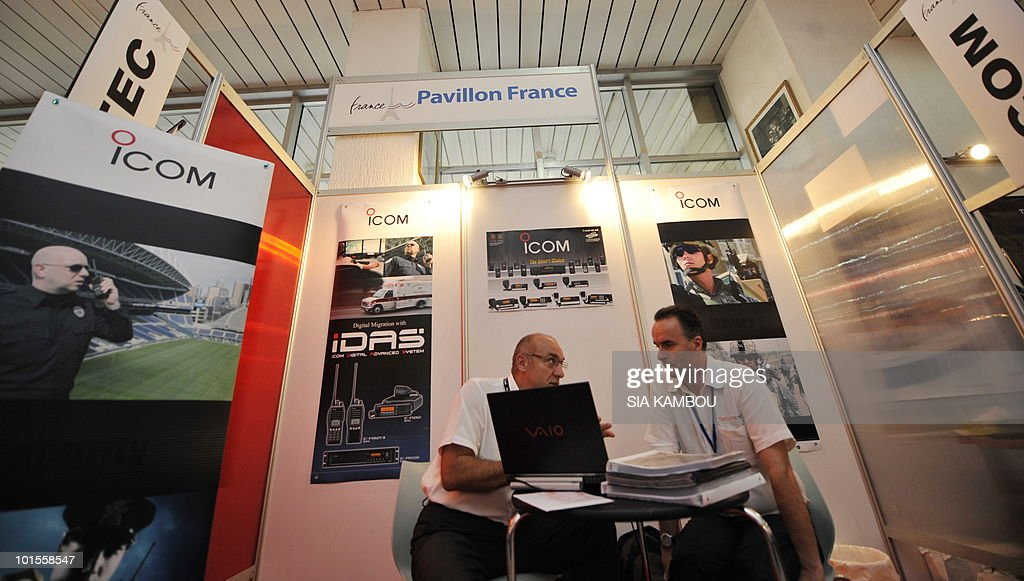 Two managers chat in their stall at the French pavillon during a trade show held in the framework of the 11th edition of the Technical and Communication Fair held at the Culture showroom in Abidjan on June.02, 2010. AFP PHOTO SIA