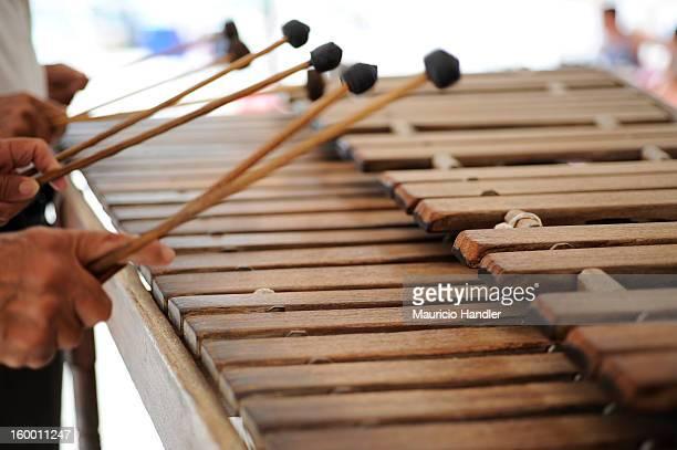 Two marimba players create music along a beach on Isla Mujeres.