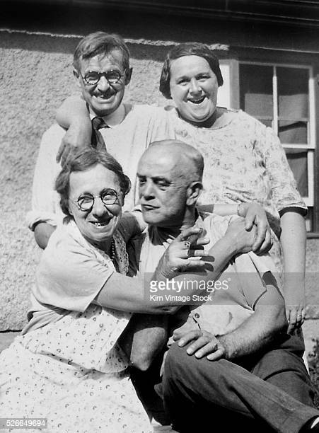 Two married couples happily group together for a portrait in the 1930s