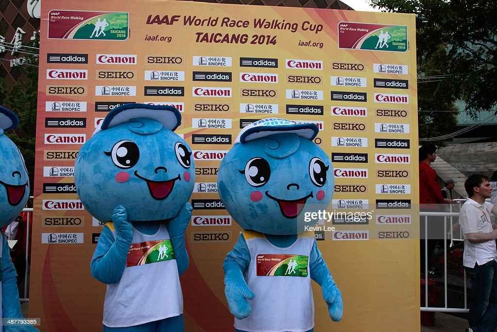 Two mascots stand in front of a board with logo of sponsoring companies at the opening ceremony of 24th IAAF World Race Walking Cup on May 2 2014 in...