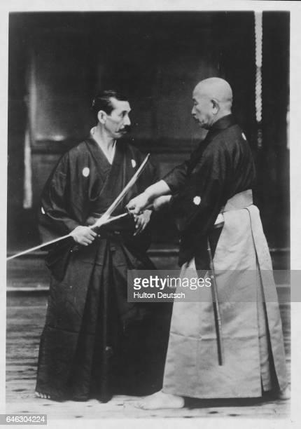 Two masters of Japanese fencing Sasaburo Takano and Hiromich Najayam engaged in combat