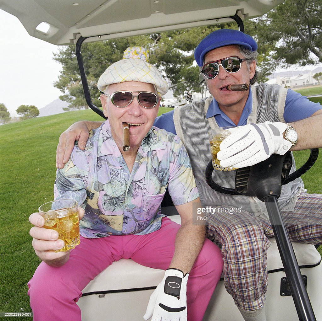 Couple Golfing On Golf Course Stock Photo - Image of