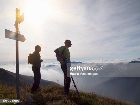 Two mature men trekking in mountains