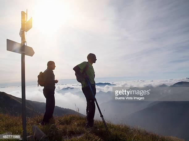 Two mature men trekking in mountains