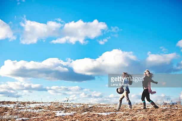 Two mature women enjoying exhilarating walk