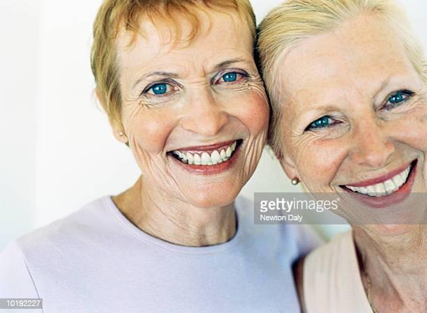 Two mature women smiling, close-up, portrait