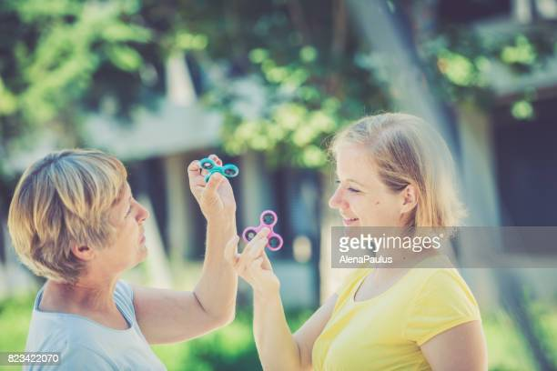 Two mature women with  spinner in hands