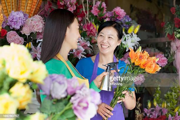 Two Mature Women Working In Flower Shop