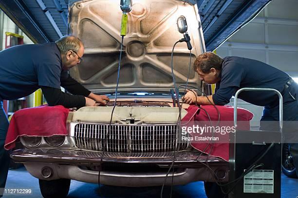 Two mechanics discuss engine repair