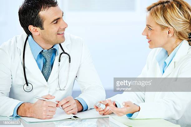 Two medical colleagues talking about the job.
